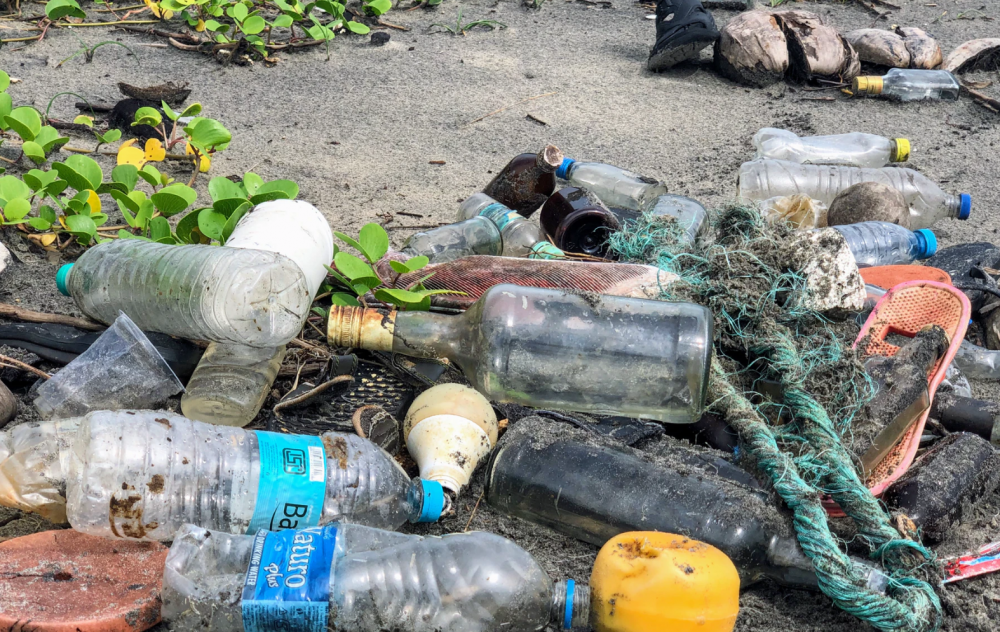 assorted garbage bottles on sandy surface photo – Free Plastic Image on Unsplash